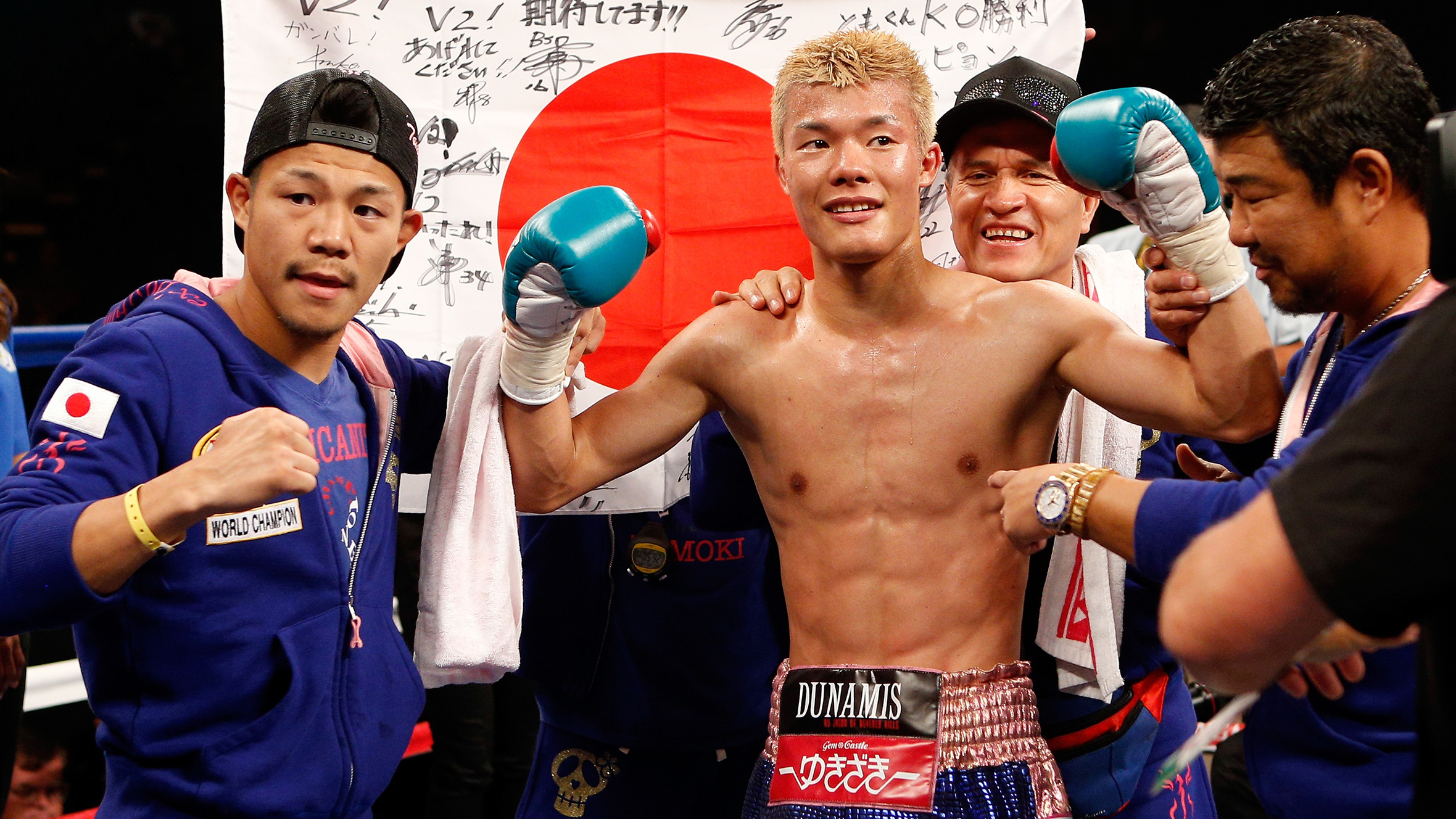 LAS VEGAS, NV - JULY 12:  Tomoki Kameda (C) of Japan poses in the ring after his seventh round knockout victory over Pungluang Singyu during their WBO bantamweight title bout at the MGM Grand Garden Arena on July 12, 2014 in Las Vegas, Nevada.  (Photo by Josh Hedges/Getty Images)