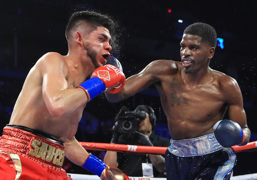top rank boxing on espn results hooker retains title stops saucedo