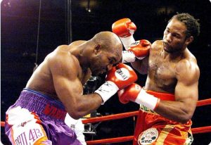 5BF0B12C 8DD9 4D24 82C7 487B8CBF2E62 300x206 - Lewis-Holyfield I: The Fight That Put Boxing Down (And Almost Out)