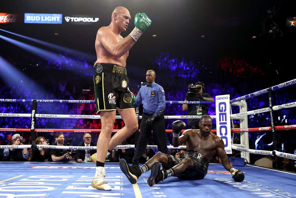 """Wilder Falling - Deontay Wilder Back Tracks From Previous Costume Claims: """"It had a little weight on it, But It wasn't enough to cause me to not have my legs"""""""